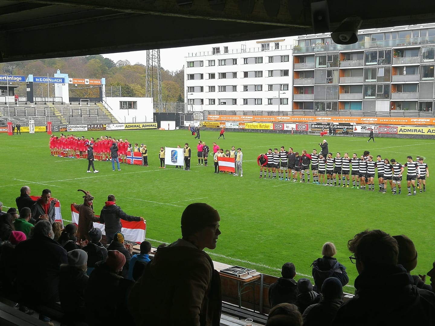 The teams line up for the national anthems